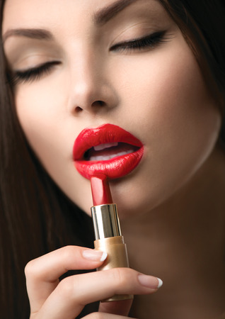 Beauty Girl Applying Lipstick  Professional Makeup Stock Photo