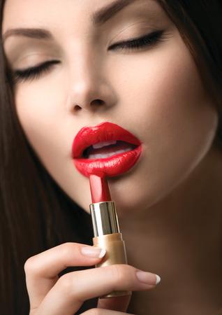 applying lipstick: Beauty Girl Applying Lipstick  Professional Makeup Stock Photo