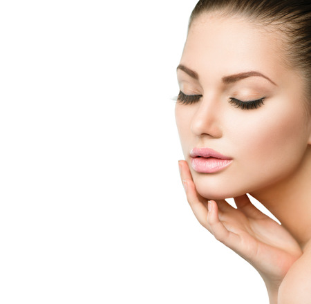 face to face: Beauty Spa Woman Portrait  Beautiful Girl Touching her Face Stock Photo
