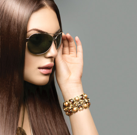 wearing: Beauty model girl with long brown hair wearing sunglasses