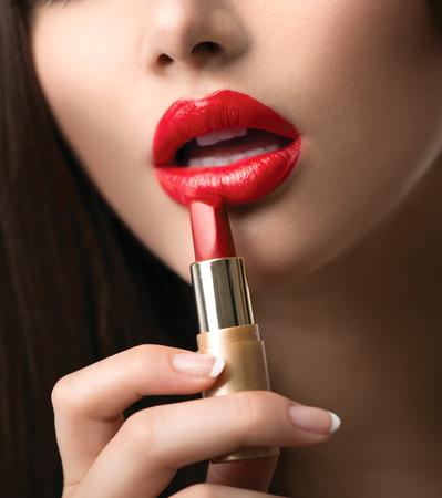 Beauty Girl Applying Lipstick  Professional Makeup photo