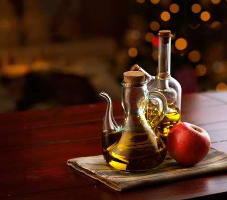 olive farm: Olive oil on a wooden table Stock Photo