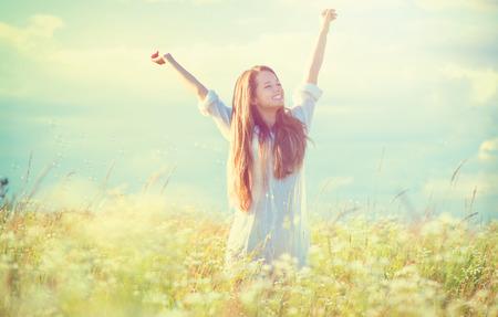 flower fields: Beauty girl outdoors enjoying nature