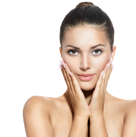 Face of Young Woman with Clean Fresh Skin over White photo