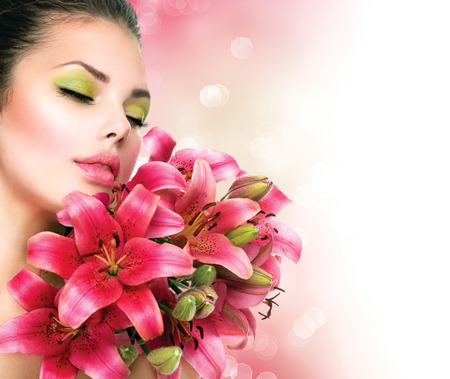 Beauty Girl with Lilly Flowers bouquet photo