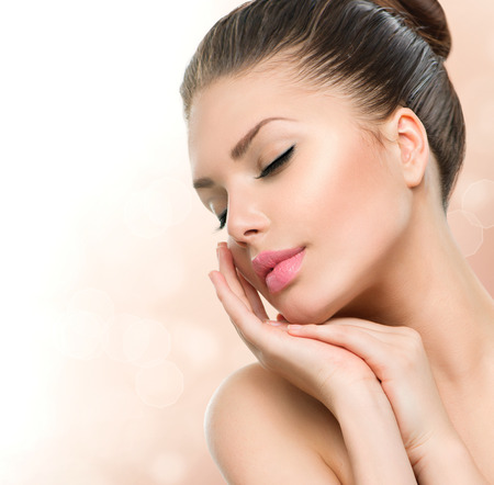 woman beauty: Beauty Spa Woman Portrait  Beautiful Girl Touching her Face Stock Photo