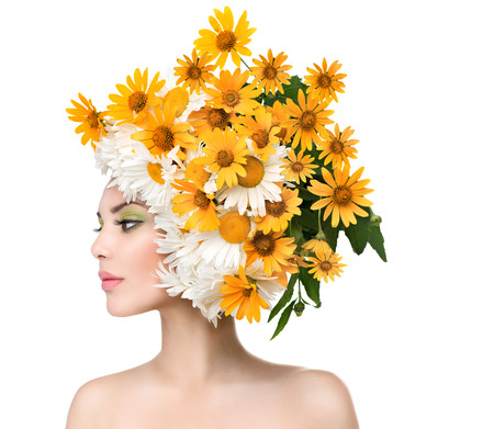 Beauty Girl with Blooming Daisy Flowers Hair Style photo