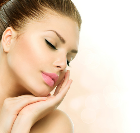 Beauty Spa Woman Portrait  Beautiful Girl Touching her Face Stock Photo