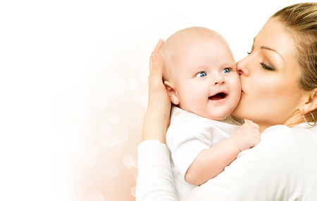 Mother and baby kissing and hugging  Mom with her child Stok Fotoğraf