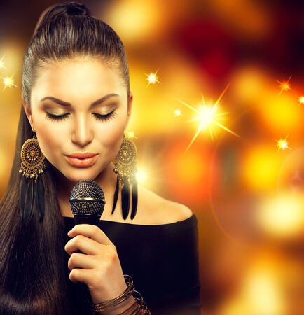 Singing Woman with Microphone over Blinking Background Stock Photo