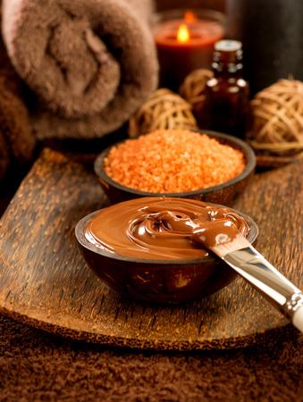 chocolate mask: Chocolate spa treatment in beauty salon closeup