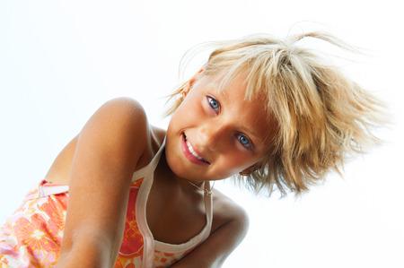 Happy cute little girl having fun outdoor photo