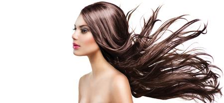 Fashion Model Girl Portrait with Long Blowing Hair Foto de archivo