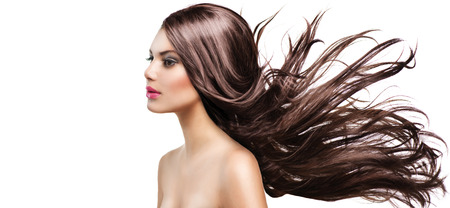 wind up: Fashion Model Girl Portrait with Long Blowing Hair Stock Photo