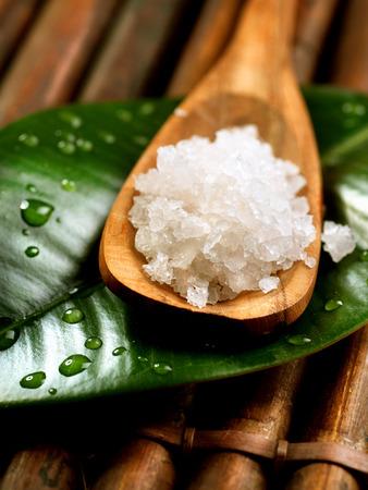vertical wellness: Spa salt in wooden spoon closeup  Bath salt