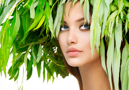 Girl with green leaves on her head  Summer woman portrait Stock Photo - 30138206