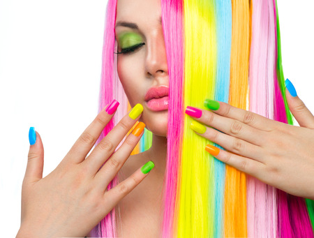 vibrant colours: Beauty Girl Portrait with Colorful Makeup, Hair and Nail polish Stock Photo