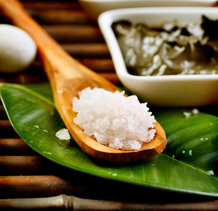 Spa salt in wooden spoon closeup  Bath salt photo