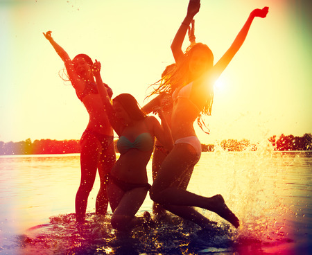 friends party: Beach party  Teenage girls having fun in water Stock Photo