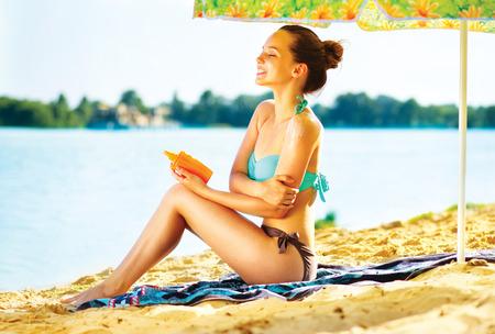 Suntan Lotion  Woman Applying Sunscreen Solar Cream photo