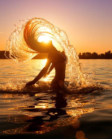 beauty model: Beauty model girl splashing water with her hair
