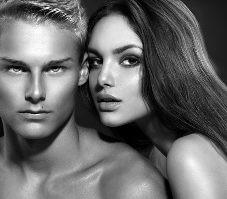 elegance fashion girls look sensuality young: Sexy couple  Young man with his girlfriend  B W portrait Stock Photo