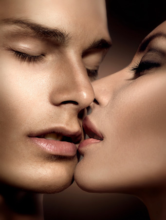 Beautiful sexy couple  Young man and beauty young woman kissing photo