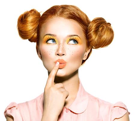 Joyful teen girl with freckles, funny hairstyle choosing