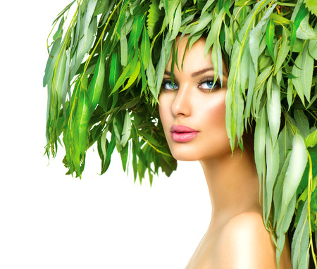 Girl with green leaves on her head  Beauty summer woman portrait Stock Photo - 30943608