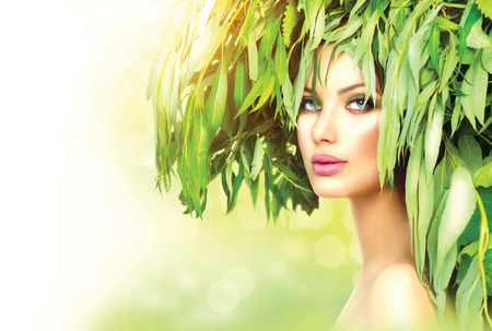 young leaf: Girl with green leaves on her head  Beauty summer woman portrait
