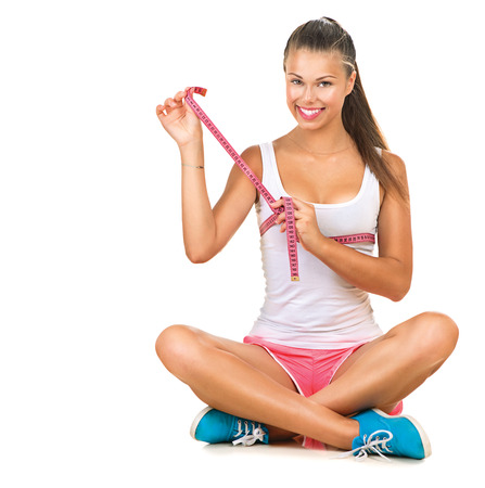 breast girl: Sporty girl checking breast measurement with a measuring tape Stock Photo