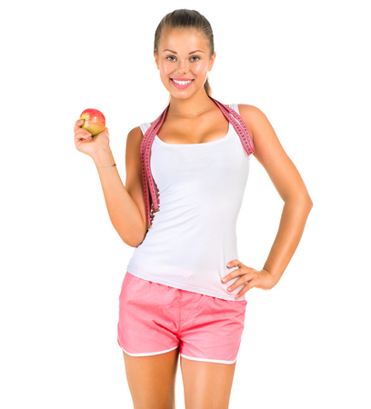 Fitness woman with a measuring tape isolated on a white photo