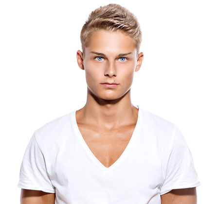 Handsome guy in white t-shirt isolated on a white photo