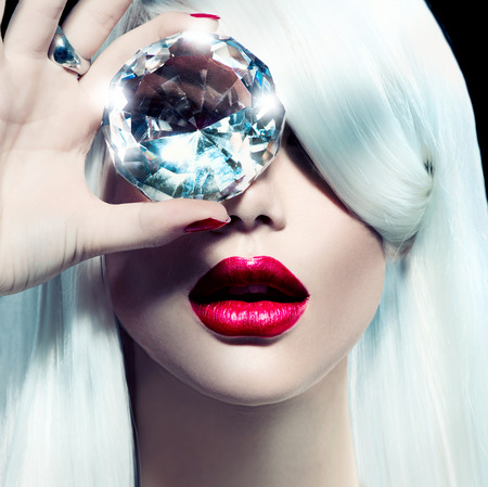 Portrait of beauty model girl with a big diamond
