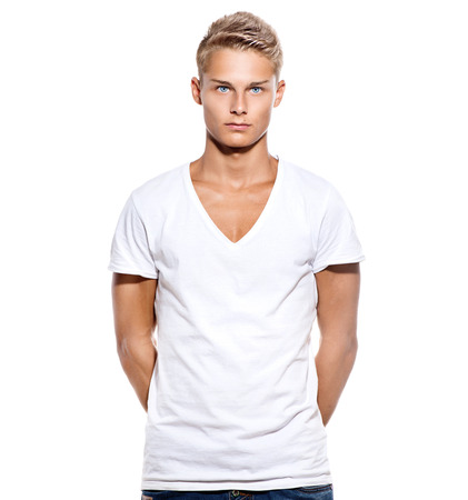 Handsome teen guy in white t-shirt isolated on white photo