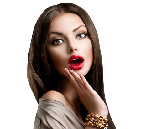 Beautiful Surprised Brunette Girl over White. Beauty Woman photo