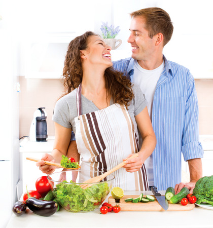 Happy Couple Cooking Together. Preparing Vegetable Salad. Diet photo