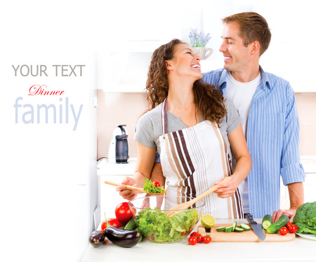 vegetables young couple: Happy Couple Cooking Together. Vegetable Salad. Dieting