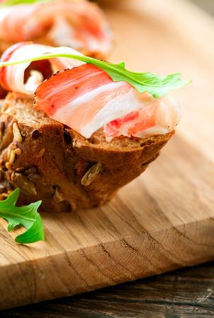 spanish tapas: Jamon. Slices of bread with spanish serrano ham served as tapas