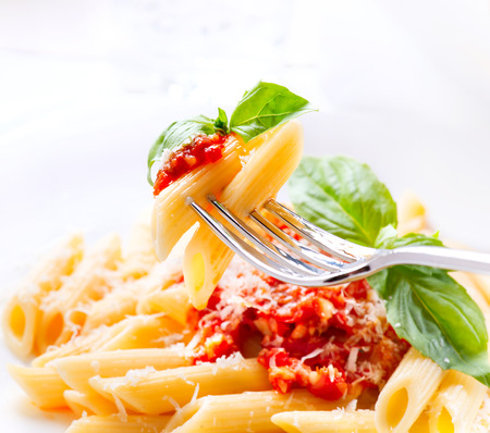 fork: Penne pasta with bolognese sauce, parmesan cheese and basil