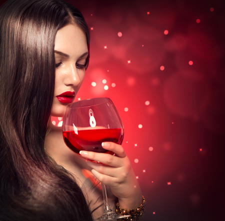 Beauty young sexy woman drinking red wine photo