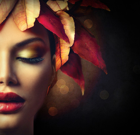 Fantasy Autumn Woman with Colourful Autumn Leaves Hairstyle Foto de archivo