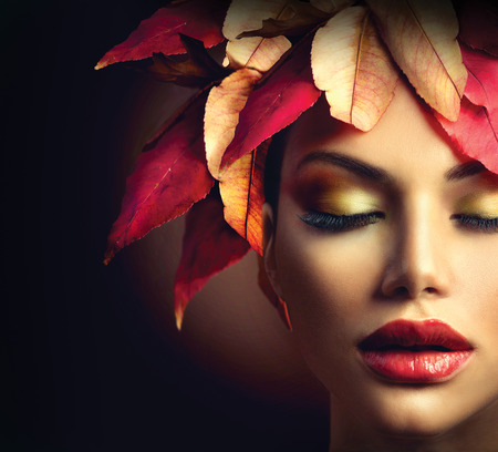 girl models: Fantasy Autumn Woman with Colourful Autumn Leaves Hairstyle Stock Photo