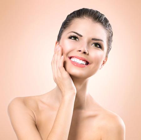 Beauty Portrait. Beautiful Spa Girl Touching her Face photo