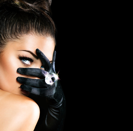 eye lashes: Vintage Style Mysterious Woman Wearing Black Gloves Stock Photo