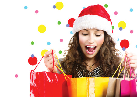 christmas promotion: Christmas sales. Surprised woman with colorful shopping bags Stock Photo