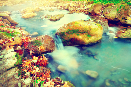 Mountain river with stones. Clear transparent fresh water photo