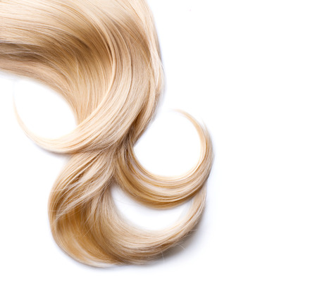 Blond hair isolated on white. Blonde lock closeup 스톡 콘텐츠