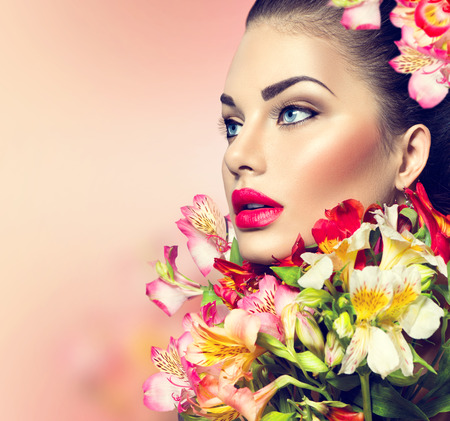 glam: High fashion model girl with colorful flowers and red lips Stock Photo