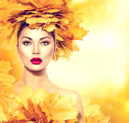 people and nature: Autumn woman with yellow leaves hair style